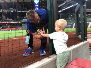 telemedicine post - athletic coach at baseball game with son