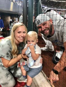 telemedicine post - physical therapist with athletic coach at baseball game 2