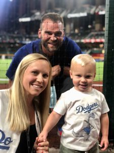 telemedicine post - physical therapist with athletic coach at baseball game